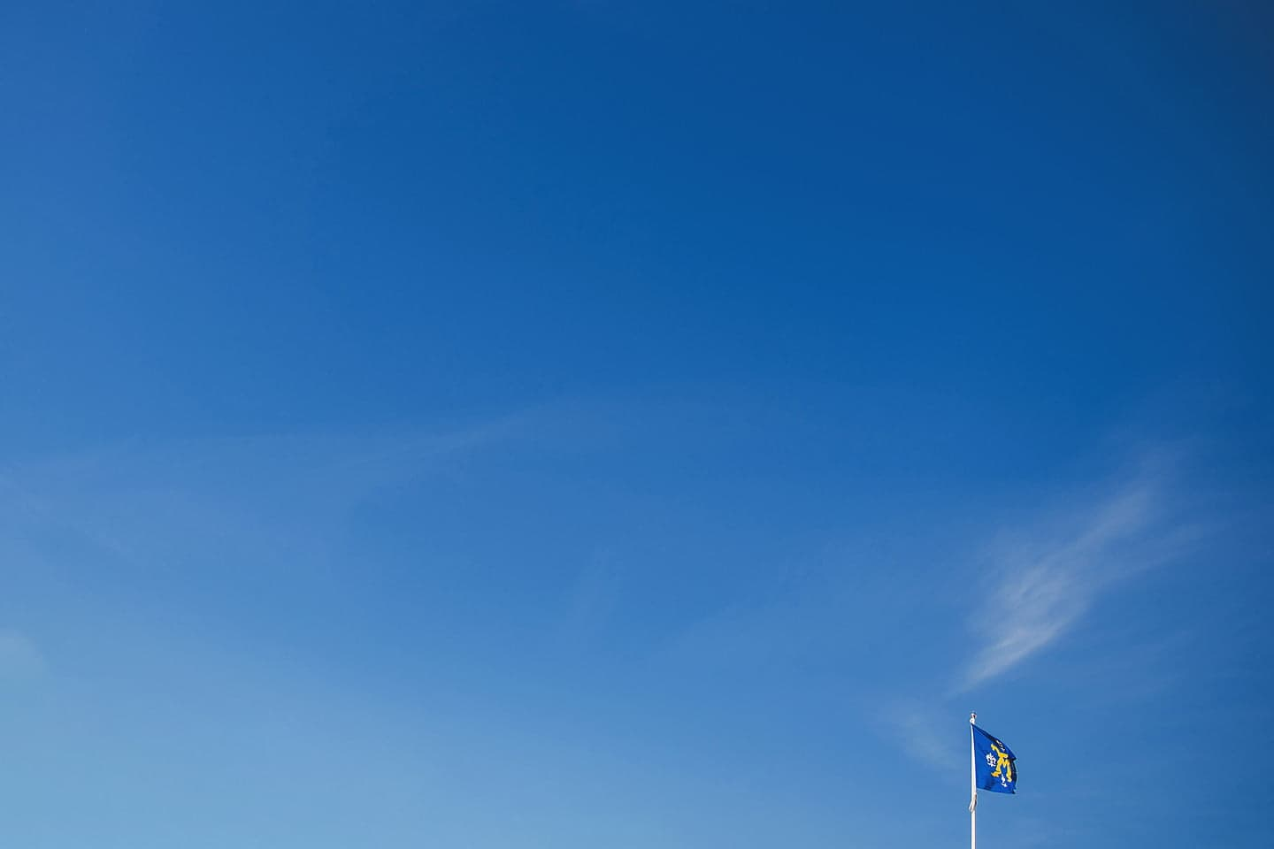 blue sky with the flag