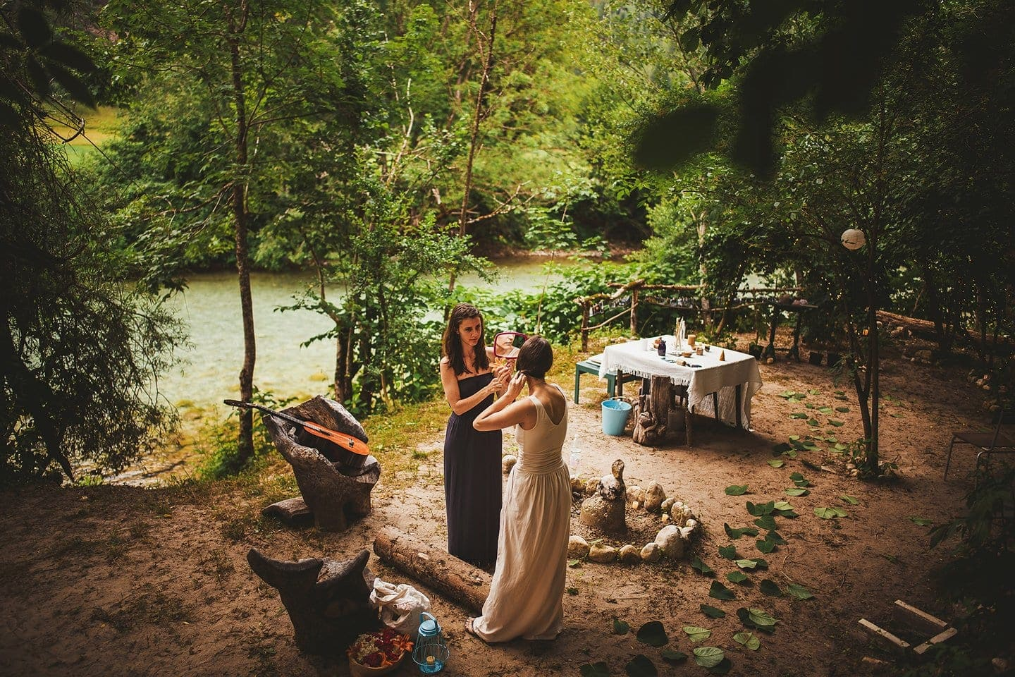 bride getting ready at wedding in the forest