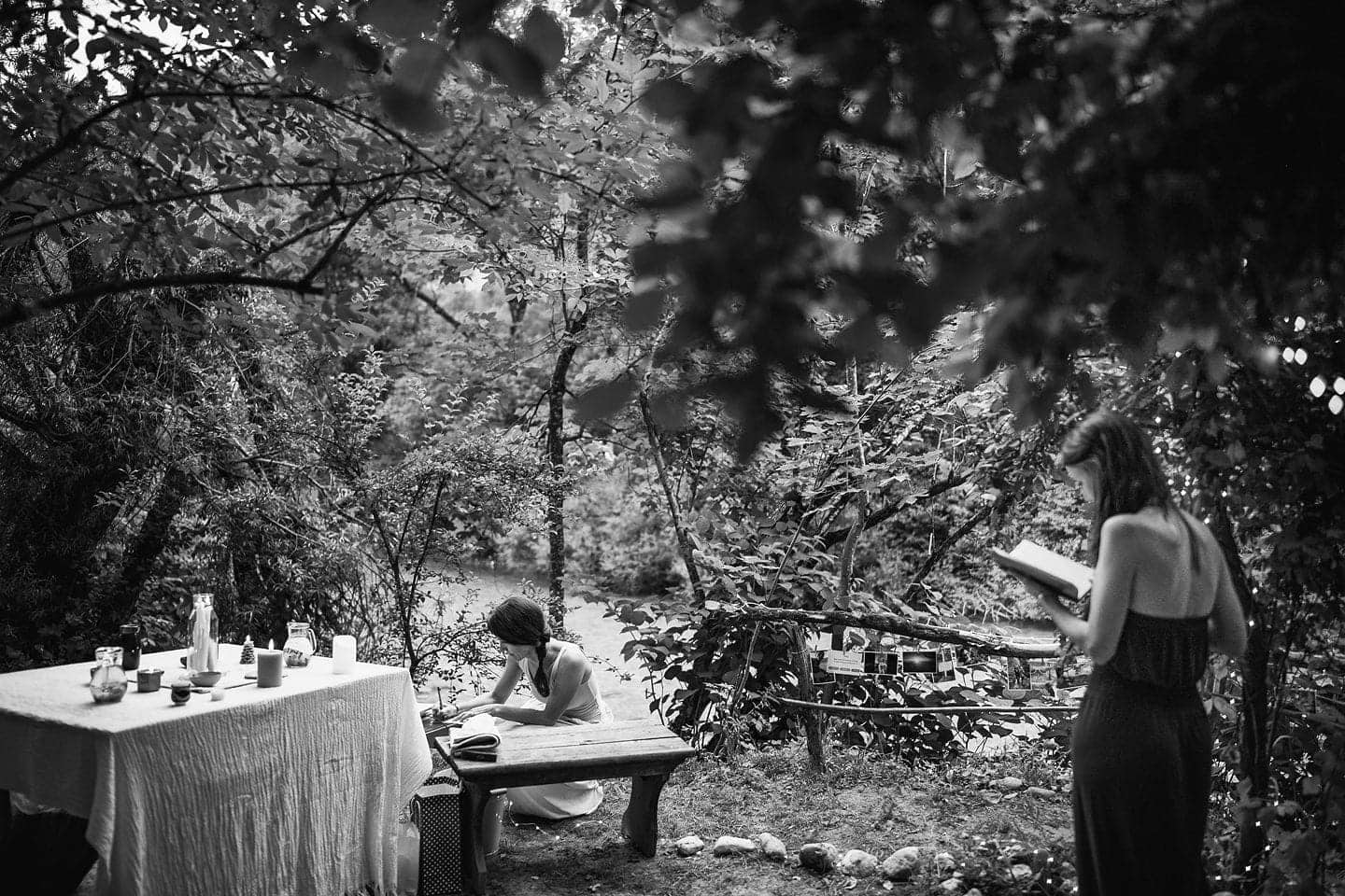bride writing the wows at wedding in the forest
